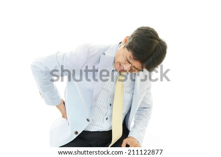 Businessman having back pain