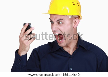 businessman having bad news on his cell phone - stock photo