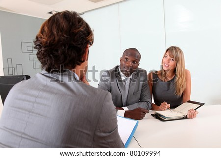 Businessman having business appointment in office - stock photo