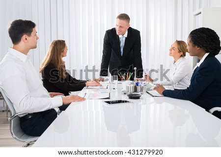 Businessman Having Discussion With His Colleague In Meeting