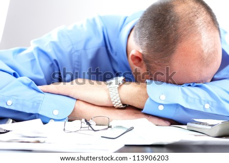 Businessman having stress in the office. Crisis