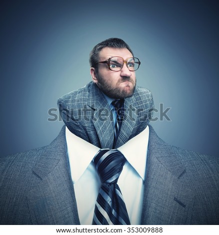 Businessman headshot with little angry businessman instead of head - stock photo