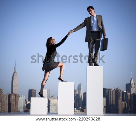 Businessman helping a colleague to succeed.  - stock photo