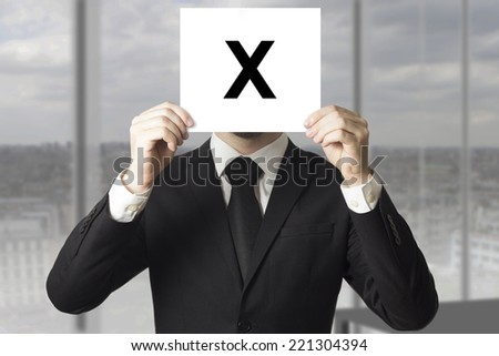 businessman hiding face behind sign crossed out - stock photo