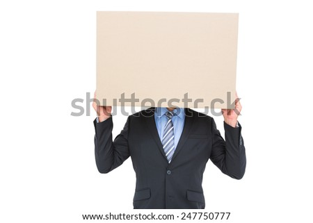 Businessman hiding head with a box on white background