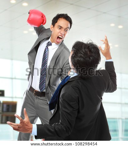businessman hit his rival in the face at the office - stock photo