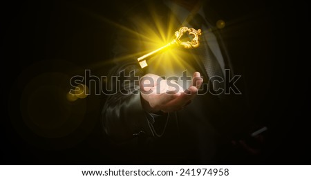 businessman hold a gold shining key, business concept