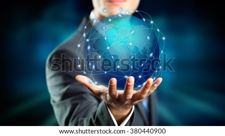 businessman hold a holographic globe over his hand