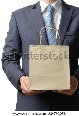 businessman hold a paper bag with both hand,business concept - stock photo