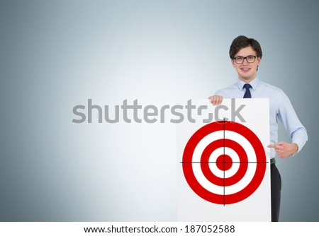 Businessman hold a poster with a target  - stock photo