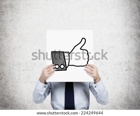 Businessman hold an icon 'thumb up' of the successful transaction.