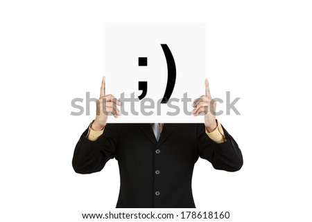 Businessman hold board with smile face emoticon isolated on white background - stock photo