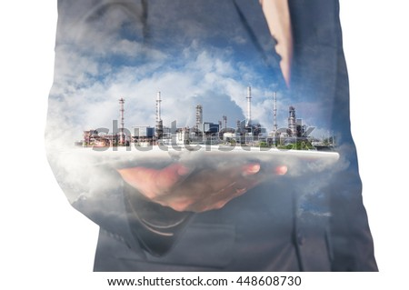 Businessman Hold Digital Wireless Tablet with Oil refinery Plant and Cloud as Digital Technology Business Concept