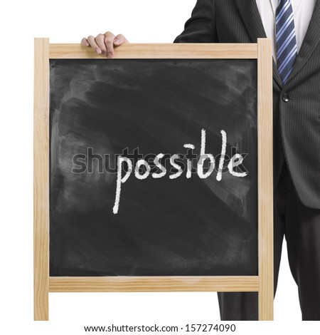 "Businessman hold dirty wooden chalk board with word ""impossible"" and erased letters ""Im"" in white background - stock photo"