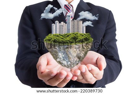 Businessman hold green city island with white background  - stock photo