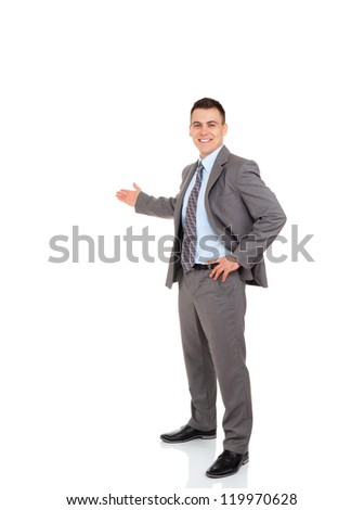 Businessman hold hand welcome gesture, Handsome young business man happy smile showing open palm, concept of advertisement product, empty copy space, full length isolated over white background - stock photo