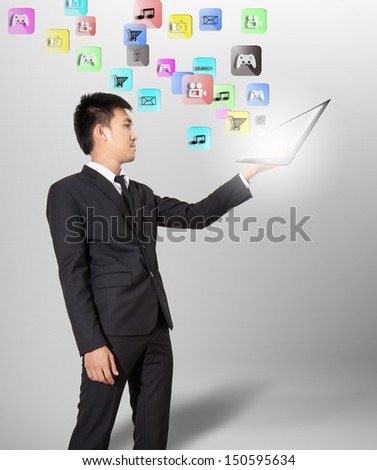 Businessman hold tablet and application in air