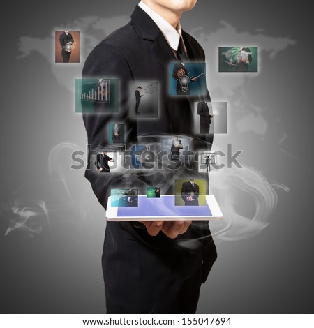 Businessman hold  tablet with digital picture high technology - stock photo