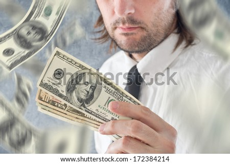Businessman hold US dollars and money raining from the sky. Paying with USA currency. - stock photo