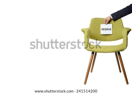 businessman hold white paper note to reserve modern green armchair  wooden leg isolated on white background,service concept - stock photo