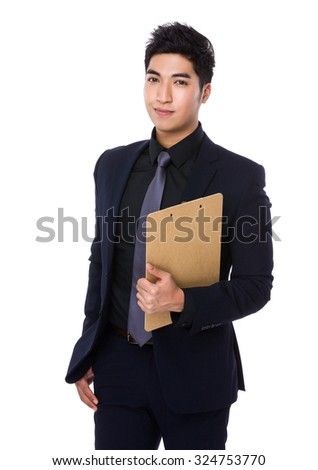 Businessman hold with clipboard - stock photo
