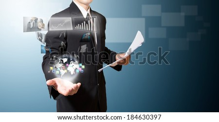 Businessman hold world of  high technology