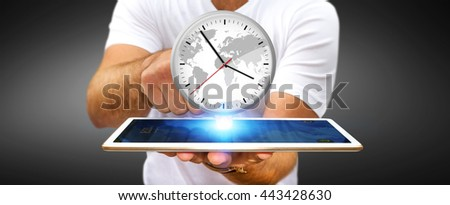 Businessman holding a big white timer over his digital tablet - stock photo