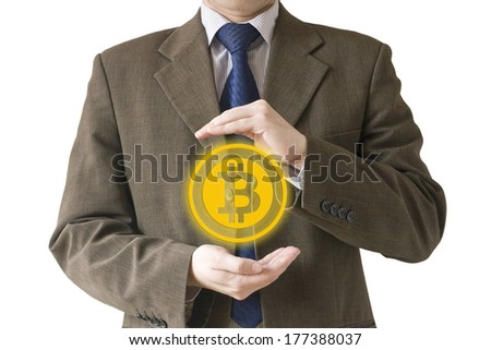 Businessman holding a bitcoin isolated on white background