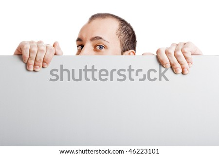 Businessman holding a blank billboard and peeking over it, isolated on white background