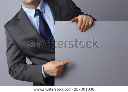 Businessman holding a blank  board . - stock photo