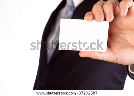 Businessman holding a blank business card for text writing