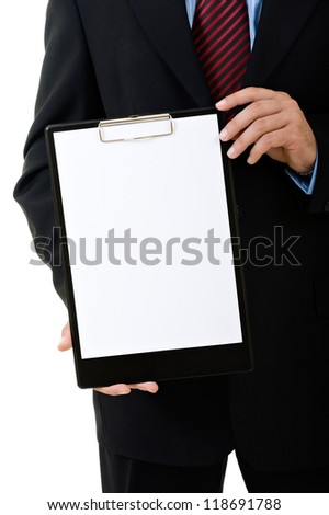 Businessman holding a blank clipboard - stock photo
