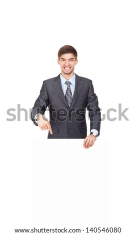 businessman holding a blank white card board, signboard, point finger showing an empty bill board, handsome young business man happy smile, isolated over white background - stock photo