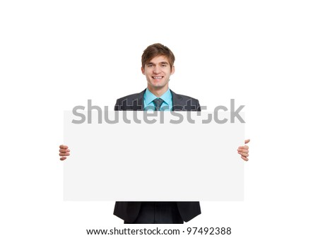 businessman holding a blank white card board, signboard, showing an empty bill board, handsome young business man happy smile, isolated over white background - stock photo