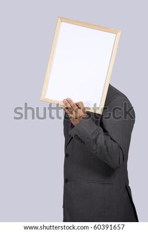 businessman holding a blank whiteboard - stock photo