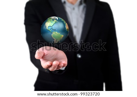Businessman holding a blue earth, globe in his hand on the white background