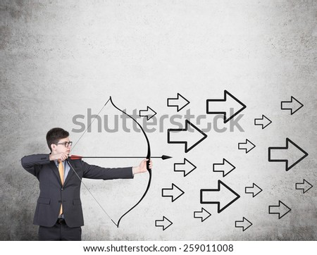 businessman holding a bow and many drawing arrow - stock photo