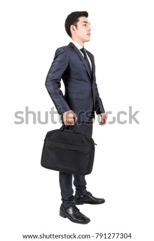 Businessman holding a briefcase isolated on white background