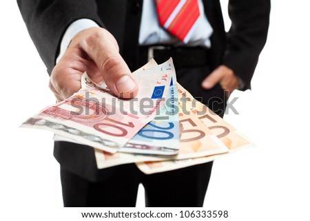 Businessman holding a bunch of money. Shallow deep of focus. - stock photo