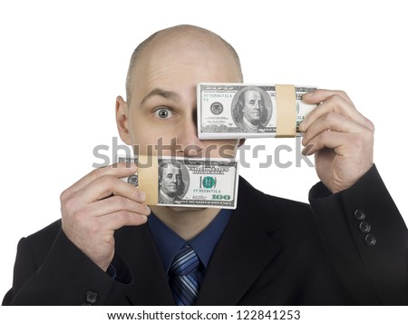 Businessman holding a bundle of money and covering his one eye using a paper currency