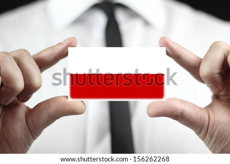 Businessman holding a business card with a Poland Flag - stock photo