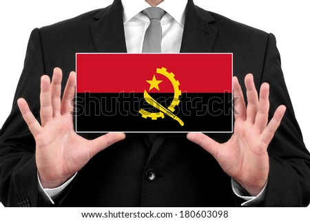 Businessman holding a business card with Angola Flag - stock photo