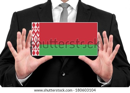 Businessman holding a business card with Belarus Flag - stock photo