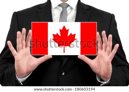 Businessman holding a business card with Canada Flag - stock photo
