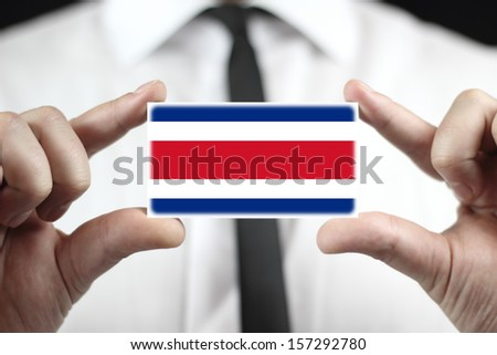 Businessman holding a business card with Costa Rica Flag