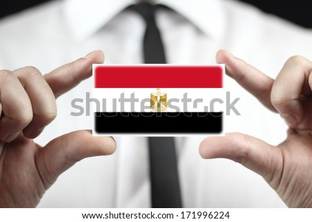 Businessman holding a business card with Egypt Flag - stock photo