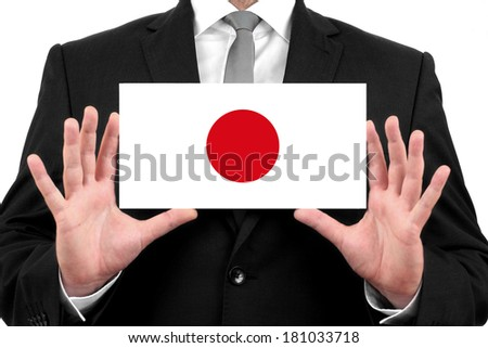 Businessman holding a business card with Japan Flag - stock photo