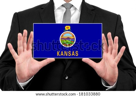 Businessman holding a business card with Kansas State Flag - stock photo