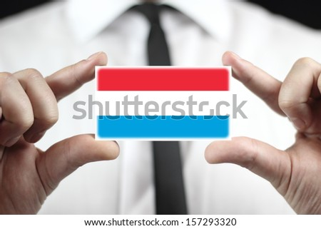 Businessman holding a business card with Luxembourg Flag