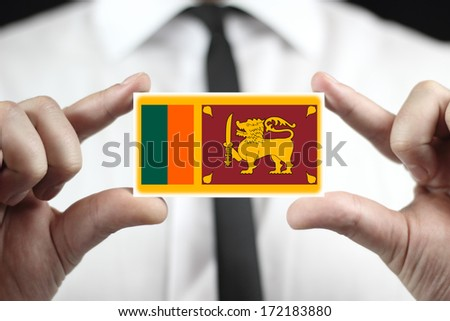 Businessman holding a business card with Sri Lanka Flag - stock photo